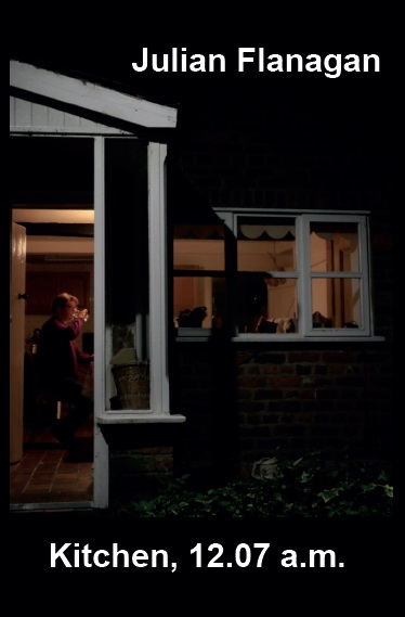 photo of man in kitchen seen through door in darkness